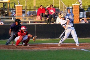 Michael Murray/Americus Times-Recorder:   Schley's Clint Sellars belts a single to bring in the Wildcats' fifth run of the April 5 contest against Marion County. Sellars contributed a pair of hits to the Schley victory.