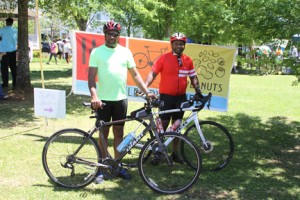 Michael Murray/Americus Times-Recorder:   Victor Hall, left, and his brother, Torey Hall, pose with their bicycles at Rees Park during the Arts in the Park event after completing the Prison to Peanuts Bicycle Adventure.