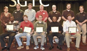 Seated, from left to right, are Student of Excellence nominees Fretavious Walker, Corey L. Long, Justin Barrera, Dannie Stewart, and Drew Payne (not pictured are Angelia S. Craig and Kenneth D. Parker). Standing, from left to right, are nominating instructors Lora Wiseman, Glynn Cobb, Tyler Wells, Mike Collins, Phil Deese, Ted Eschmann, and Gil Pittman.