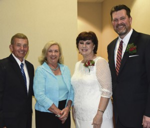 Shown are President Emeritus Sparky and Allene Reeves, at left,  with new President John and Barbara Watford.