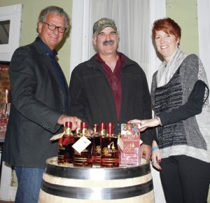 Owner Erik Vonk, left, and distiller Roger Zimmerman, center, pitch Char-Broil® CEO Chris Robins on the merits of Richland Rum at the inaugural Taste of Richland in 2014.