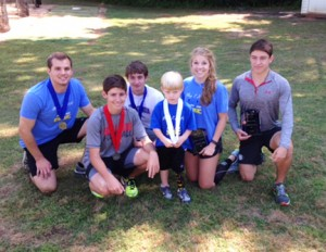 Photo submitted by Patrick Calcutt:   Caleb stops for a photo after awarding medals to Southland Academy runners following the race. From left: Southland alumnus Ryan Singley, Gray Torbert, Brian Miller, Caleb, Chris Shattles and Billy Calcutt