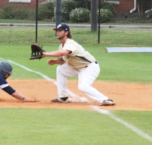 ATR File Photo:   GSW first-baseman, Davey King, crouches down to snag a throw during a 2016 contest. King was recently named to the PBC All-Academic Team.