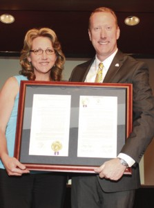 GSW Outstanding Scholar Carleen Wise, left, is presented with a framed resolution from the both the Georgia House of Representatives and the Georgia Senate. GSW Interim President Charles Patterson is shown with her.