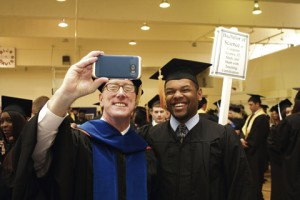 Georgia Southwestern Interim President Charles Patterson, left, takes a selfie with Michael Lawson of Moultrie prior to commencement.