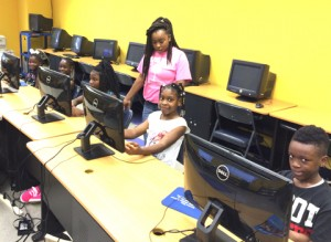 May, standing, a junior staff member, with some of her charges at the Americus-Sumter Boys & Girls Club's Summer Camp in Americus. Club members, from left, are Jakalyn, Gwenesha, Jakierra, Ny-kierra and Ja'niyah.