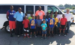 Submitted by Dwight Harris, Sr.:   Members of the DHBC stand in front of the van that was recently donated to the club by Langdale Automotive, of Americus.