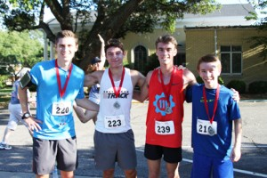 Submitted Photo:   Some of the winners of the race pose with their awards. From left; Alex Arnold, overall second-place winner; Billy Calcutt, overall first place winner, Wright Calhoun, and overall third-place winner, Aaron Pinckard.