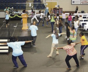 Ashley Patterson, registered dietitian at Phoebe Sumter, leads a yoga demonstration at the Women's Health Conference.