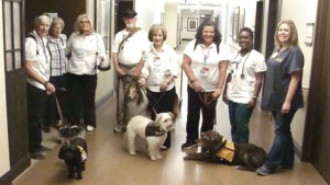 Group photo with dogs, their handlers and Phoebe Sumter guest,  Mary Thompson.