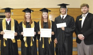 Luke Ellis from Abraham Baldwin Agriculture College, far right, is shown presenting the Allan C. and Leila J. Garden Scholarship ($1,000) to Blake Howell, Bailey McLain, Carley McLain, and Brett Usry.