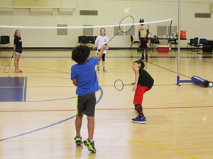Michael Murray/Americus Times-Recorder:   Participants in the GSW Sports and Science Summer Camp practice their sbadminton skills under the guidance of former Lady Hurricanes team member, Shanedra Lockett, in Americus.