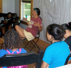 Marilyn McGinnis leads discussion on recycling, human rights, and other issues.