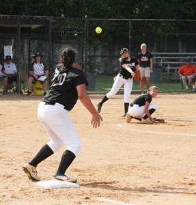 Michael Murray/Americus Times-Recorder:   Southland's Hannah Philpott (rear) fires the ball off to first baseman, Kaitlyn Smith (foreground) to dispatch a Valwood batter on August 22 in Americus.