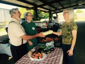 William and Lydia Overholt of Marshallville sell brown eggs to Susie Nordwell of Americus.