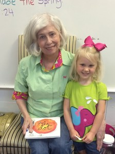 Mary Beth Rogers aka Sloan Arnold's Meme read to the 3K Blueberries and taught the children how to use their heads and fingers to create art. She is a retired art teacher. Also, Ruth Jones (former Southland Academy French teacher and Kenzie Jones aka Miss Gat) read to the 3K Blueberries weekly. Shown are Mary Beth Rogers with granddaughter Sloan Arnold.)