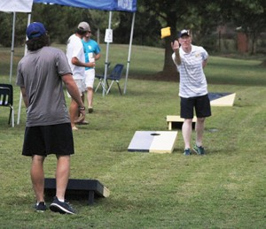 Michael Murray/Americus Times-Recorder:   GSW Interim President, Charles Patterson, joined in the fun on Sept. 24, participating in the 'Canes Cornhole Tournament that was held during the soccer matches at Hurricane Field.