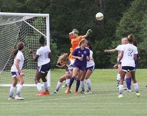 Michael Murray/Americus Times-Recorder Lady Hurricane senior goalkeeper, Elyse Gowen, (in rear) deflects a prospective shot during the first half of GSW's Sept. 15 home contest against MGSU.