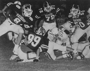 From the 1987 Southland Academy yearbook: Southland's David Roach (8) carries the ball around a series of Mt. DeSales defenders as his teammates provide protection during the Raiders' Nov. 14, 1986 playoff contest against the Cavaliers.