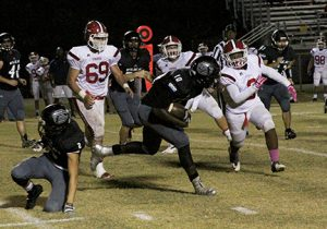 Michael Murray/Americus Times-Recorder:   Schley tight end, Zykievious Walker, braces for impact as a Pacelli linebacker approaches during the second half of the Wildcats' Oct. 28 tilt against the St. Anne-Pacelli Vikings.