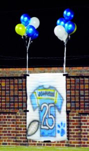Photo by Caitlin Boland/The McDuffie Progress:   Players and students from Thomson High School displayed a touching tribute to former Panther team member, Jamorrian Johnson, who tragically passed two weeks ago.