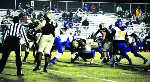 Photo by Caitlin Boland/ The McDuffie Progress:   Th ASHS' Panthers' powerful defensive line clashes with a determined Thomson offense during the teams' Nov. 11 playoff meeting.