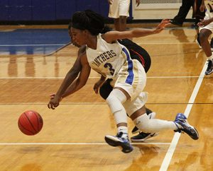 Michael Murray I ATR:   ASHS' Jykiera Long scrambles for a loose ball alongside a Lee County opponent during the Lady Panthers' Nov. 19 tilt against the Lady Trojans.