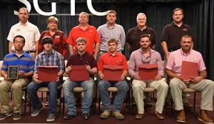 Seated, from left, are SGTC Student of Excellence nominees Feng Xie, Kaleb Tyler York, Alex Hill, Tyler Holt, Ben Adams, and Wesley Brazier. Standing, from left, are nominating instructors Glynn Cobb, Lora Wiseman, Mike Collins, Tyler Wells, Phil Deese, and Ted Eschmann. Not pictured are nominee Jorge Lara and his instructor Gil Pittman.