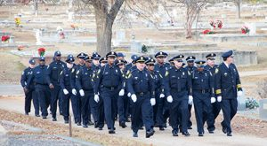 Officer Nick Smarr's fellow officers in their escort to Oak Grove Cemetery for Smarr's burial