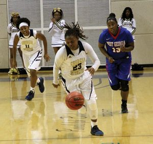MICHAEL MURRAY I ATR:   GSW's Brittany Grant makes a break for the bucket with a UWG player in hit pursuit during the Lady Hurricanes' Nov. 30 contest.