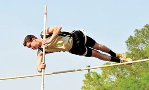 MICHAEL MURRAY I ATR:   In this photo, from the April 9, 2016 edition of the Times-Recorder shows Southland pole vaulter, Brody Shattles, taking a powerful leap over the bar during the GISA Region 3-IAAA meet in Albany. Southland went on to send 19 track and field athletes to the state meet several weeks later.
