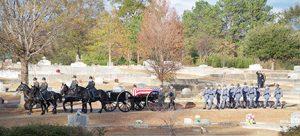 The Georgia State Patrol Honor Guard followed the caisson into Oak Grove Cemetery.