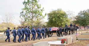 The North Carolina Troopers Assoociation Caisson Unit escorts the casket of Officer Nick Smarr into Oak Grove Cemetery.