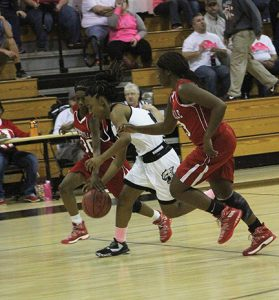 MICHAEL MURRAY I ATR: Schley County's Chelsey Carter (center) attempts to steal the ball from a Lady Red Devil foe during the second half of the Lady Wildcats' Dec. 2 contest against Hawkinsville. Carter contributed 12 points to the Schlaey cause in the match-up.