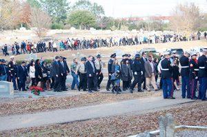 And the stream of people kept coming and kept coming for the burial of Americus Police Officer NIck Smarr.
