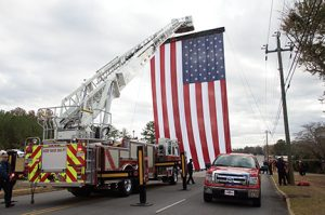 Americus Fire & Emergency Services displayed its huge U.S. flag on  Tripp Street Sunday in honor and remembrance of Americus Police Nick Smarr.