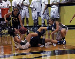 MICHAEL MURRAY I ATR:   Southland's Kathleen Kinslow (left) scuffles with an SGA opponent for possession as Cassi Bass (right) prepares to snag the loose ball during the Lady Raiders' Nov. 29 contest against SGA in Americus.