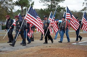 Veterans carrying American flags were also part of the funeral cortege of Americus Police Officer Nick Smarr as his casket was borne from the GSW Storm Dome to Oak Grove Cemetery for burial.