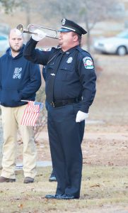 A bugler plays Taps toward the end of the funeral service for Americus Police Officer Nick Smarr in Oak Grove Cemetery on Sunday afternoon.