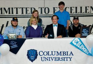 SUBMITTED BY SOUTHLAND ACADEMY:   Shown above, in a pfoto from the Feb. 13 edition of the Times-Recorder, Southland defensive end, Taylor Weldon, prepares to sign a national letter of intent to play football at Columbia University as his family members and Raider head coach, Rod Murray (at right) look on.