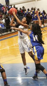 MICHAEL MURRAY I ATR:   ASHS' Tykiera Long takes a jumper from the key during the Lady Panthers' Dec. 9 tilt against Crisp County in Americus. Long contributed eight points to the ASHS victory.