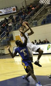 MICHAEL MURRAY I ATR: Tyrone Wooten (right) takes the ball to the bucket during the first half of the GSW Hurricanes' Dec. 14 tilt against Fort Valley State. Wooten both recorded a double double in the Hurricanes' home victory.