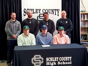 MICHAEL MURRAY I ATR:   This photo, from the Feb. 24, 2016 edition of the Times-Recorder, shows Schley County baseball players, (seated, from left) Brett Usry, Michael Leeder, and Blake Howell, moments before signing national letters of intent to continue their baseball careers on the collegiate level in front of members of the Wildcats' coaching staff.