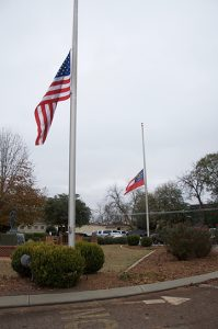 The flags were flown at half-staff at the Griffin Bell Conference Center Wednesday in observance of the slain Americus Police officer, Nicholas  Smarr.