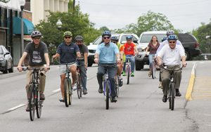 "MICHAEL MURRAY I ATR:   In this photo, from the May 28, 2016 edition of the Times-Recorder, Americus mayor, Barry Blount (center) is seen taking a bike ride with members of Sumter Cycling and other local residents after declaring Americus a ""complete streets"" town."