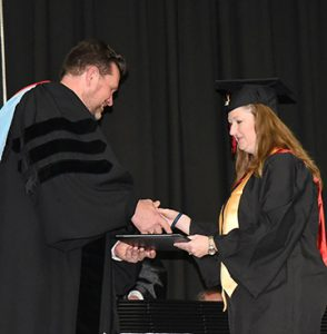 Jamie Campbell of Americus, a Presidential Honor Graduate, earned an associate of applied science degree in accounting. She is shown receiving her diploma from President Watford.