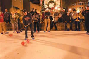 NICOLE BUCHANAN I ATR:   A member of the Kiwanis team winds up to take a shot during the first annual Kiwanis/Rotary broomball competition in downtown Americus on Dec. 30. The Kiwanis Club ended up winning the match-up in an overtime shootout.