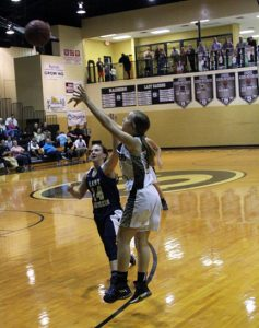 MICHAEL MURRAY I ATR: Southland's Cassi Bass launches a three-pointer to bring the Lady Raiders within two points of Tiftarea's lead on Jan. 13 in Americus.