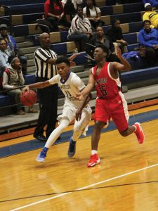 MICHAEL MURRAY I ATR:   ASHS senior, Eric Hall, drives past an NHS defender during the Panthers' Jan. 10 match-up against the Patriots in Americus. Hall led the team with 16 points in the win.