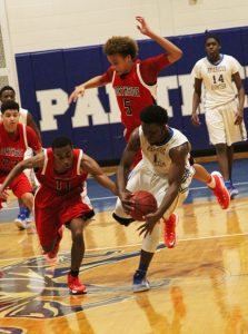 MICHAEL MURRAY I ATR:   ASHS' Jurrell Jones scrambles for a loose ball during the Panthers' Jan. 10 tilt against NHS in Americus. Jones tossed in 15 points in the Panther win.